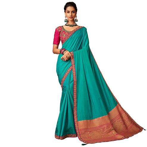 Opulent Sky Blue Colored Partywear Embroidered Raw Silk Saree
