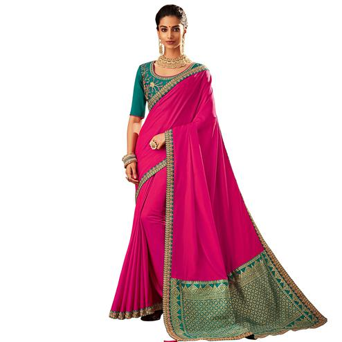 Glowing Rani Pink Colored Partywear Embroidered Raw Silk Saree