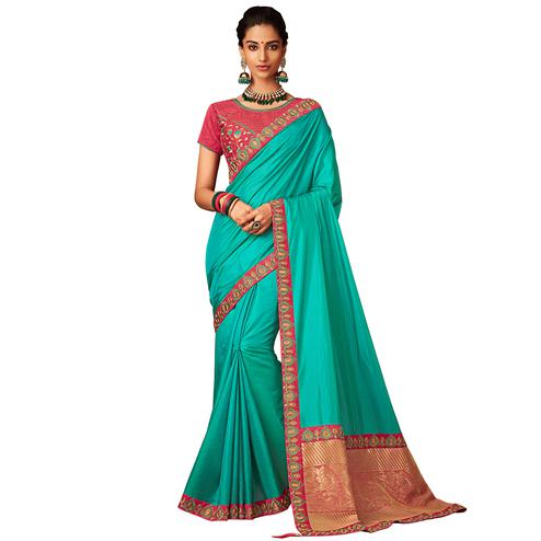 Gleaming Sky Blue Colored Partywear Embroidered Raw Silk Saree