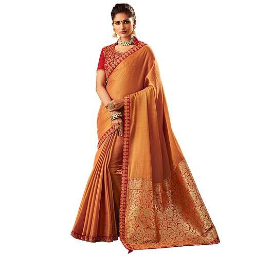 Unique Light Orange Colored Partywear Embroidered Banarasi Silk Saree