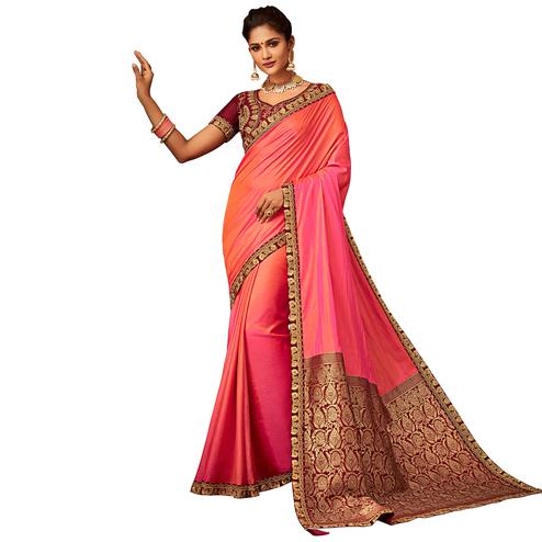 Magnetic Peach Colored Partywear Embroidered Raw Silk Saree