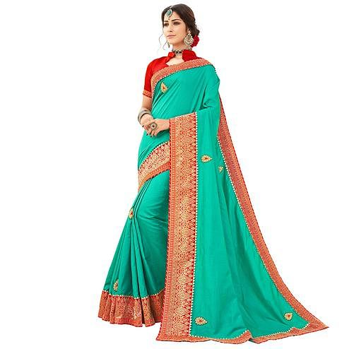 Desirable Turquoise Green Colored Partywear Embroidered Raw Silk Saree
