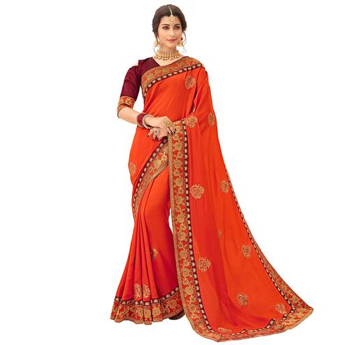 Sophisticated Orange Colored Partywear Embroidered Satin Silk Saree