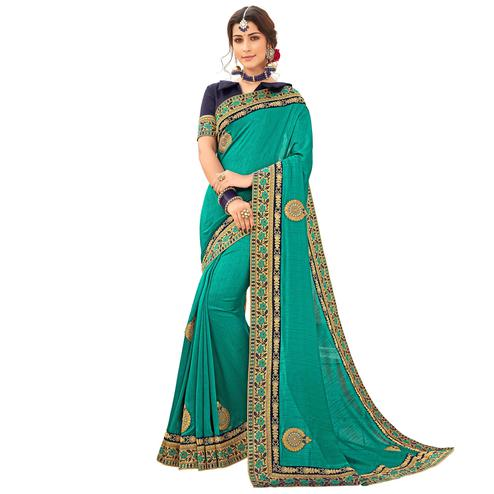 Elegant Turquoise Green Colored Partywear Embroidered Silk Saree