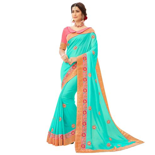 Pleasant Cyan Colored Partywear Embroidered Satin Silk Saree