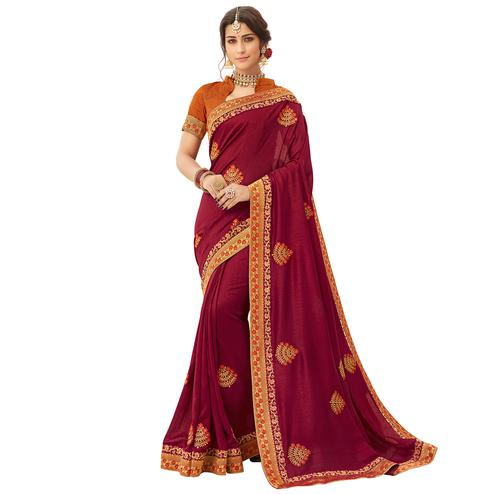 Opulent Maroon Colored Partywear Embroidered Silk Saree