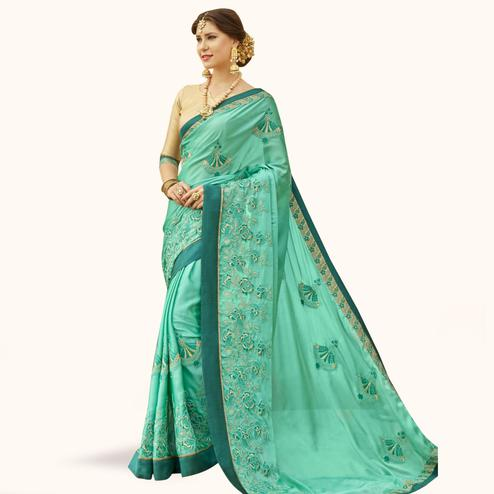 Trendy Aqua Green Colored Partywear Embroidered Georgette Saree