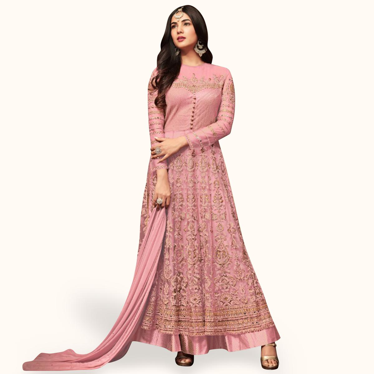 Flaunt Pink Colored Partywear Embroidered Netted Lehenga Kameez