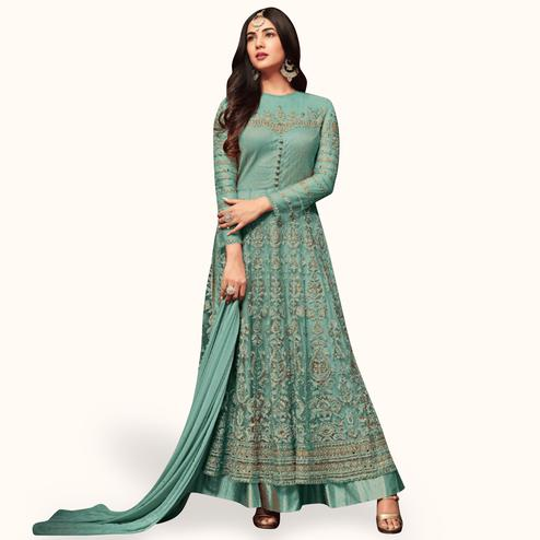 Stunning Sky Blue Colored Partywear Embroidered Netted Lehenga Kameez