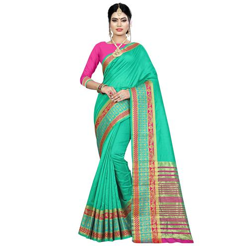 Dazzling Turquoise Green Colored Festive Wear Woven Art Silk Saree