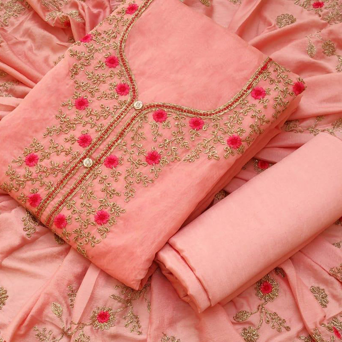 Amazing Peach Colored Partywear Embroidered Chanderi Silk Dress Material
