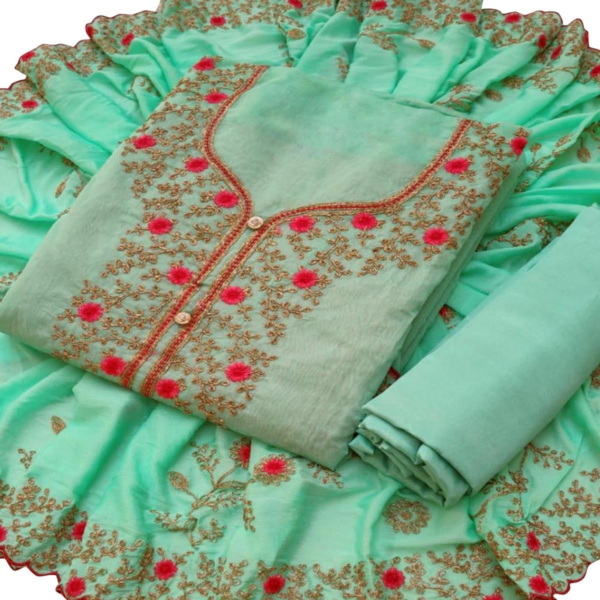 Refreshing Aqua Blue Colored Partywear Embroidered Chanderi Silk Dress Material