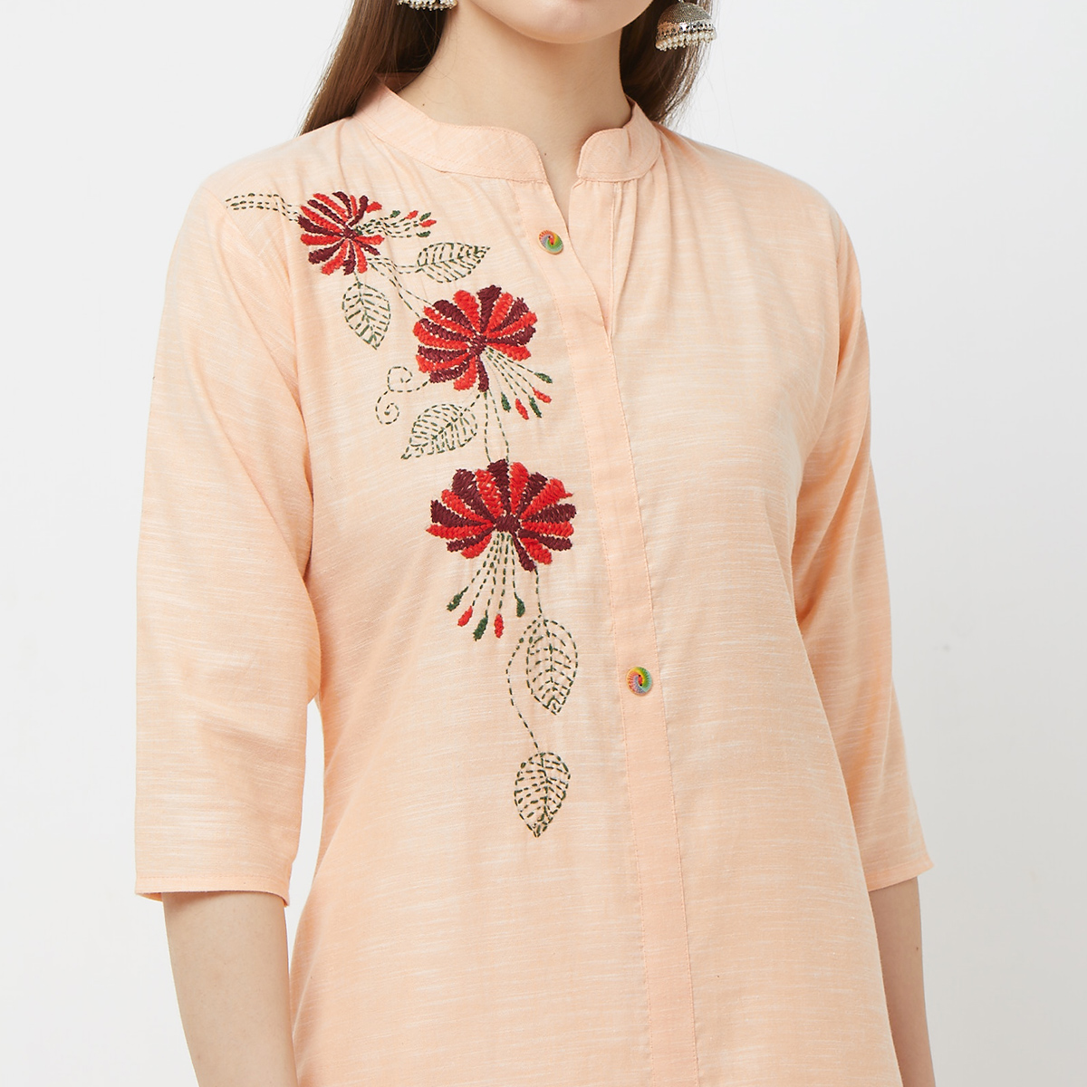 Exotic Peach Colored Casual Floral Embroidered Cotton Kurti