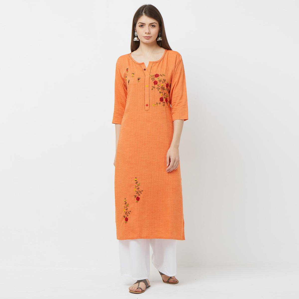 Demanding Orange Colored Casual Floral Embroidered Cotton Kurti