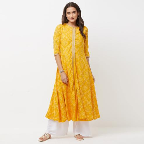 Gorgeous Yellow Colored Printed Partywear Cotton Kurti