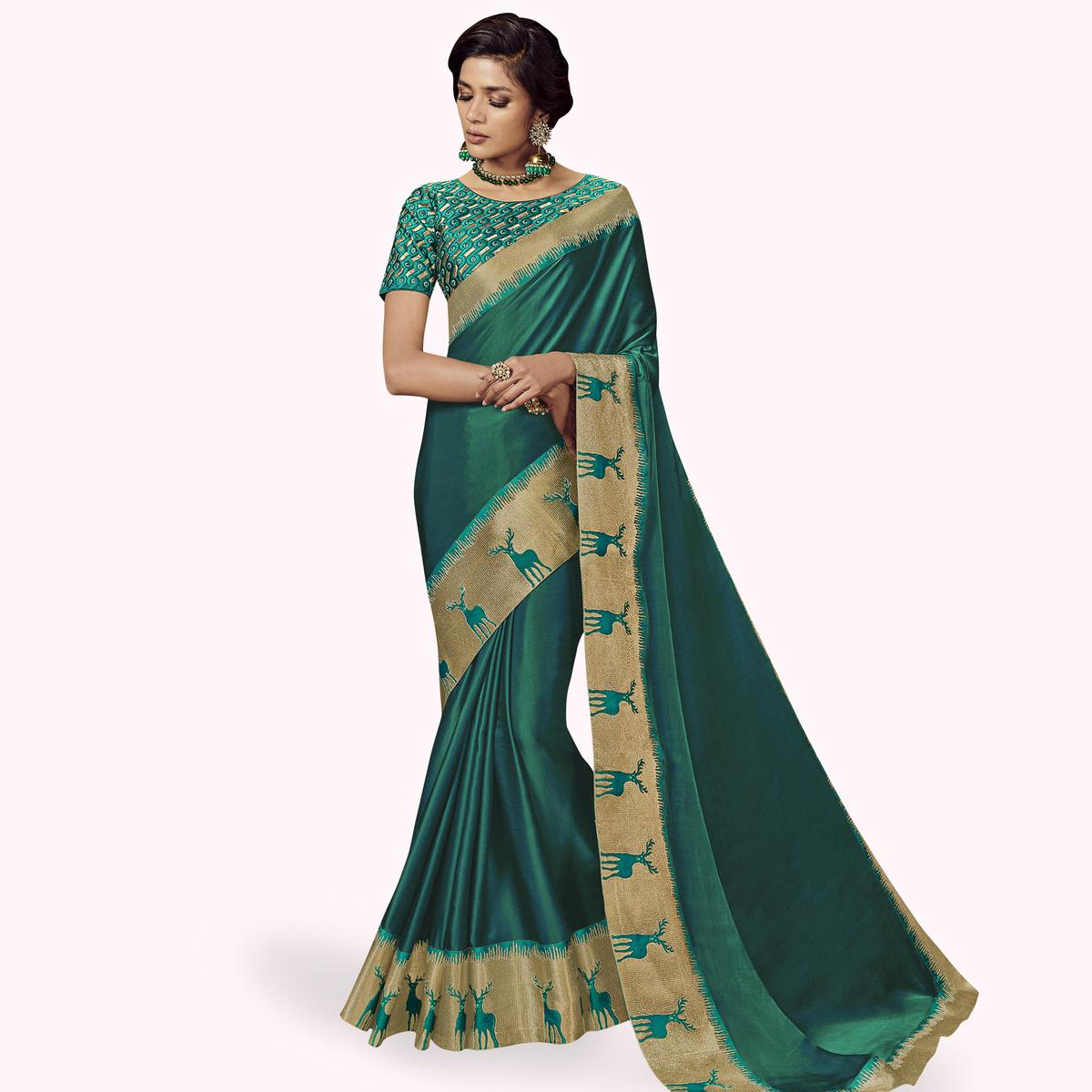 Sophisticated Turquoise Green Colored Partywear Embroidered Satin Silk Saree