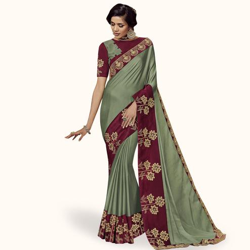 Elegant Pastel Green Colored Partywear Embroidered Satin Silk Saree