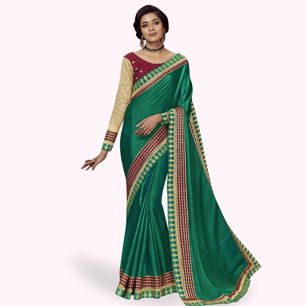 Exceptional Turquoise Green Colored Partywear Embroidered Satin Silk Saree