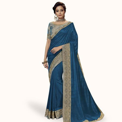 Gleaming Blue Colored Partywear Embroidered Satin Silk Saree