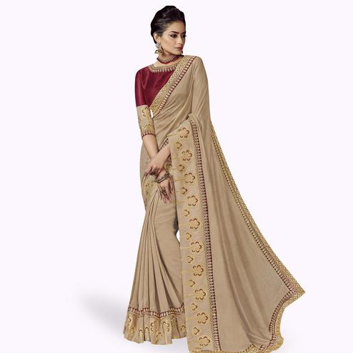 Mesmeric Beige Colored Partywear Embroidered Satin Silk Saree