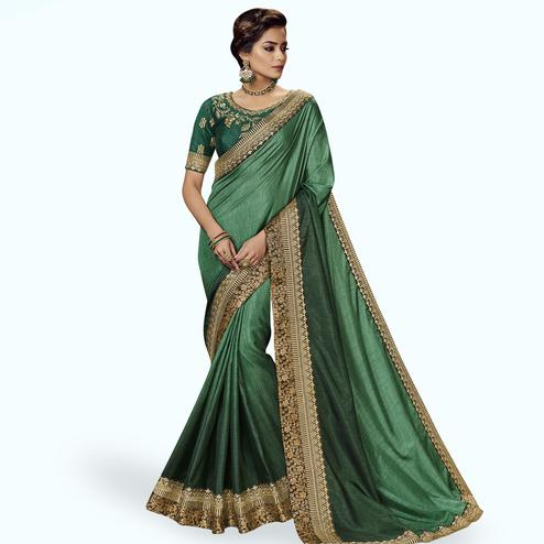 Hypnotic Green Colored Partywear Embroidered Satin Silk Saree