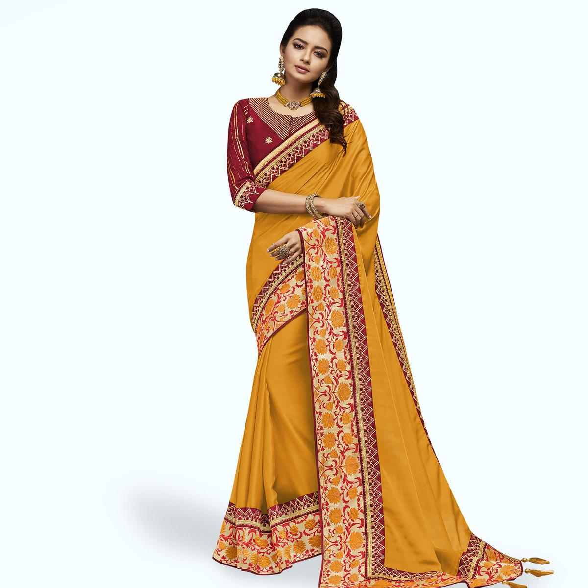 Charming Yellow Colored Partywear Embroidered Satin Silk Saree