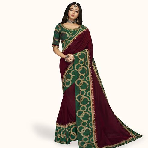 Jazzy Maroon Colored Partywear Embroidered Satin Silk Saree