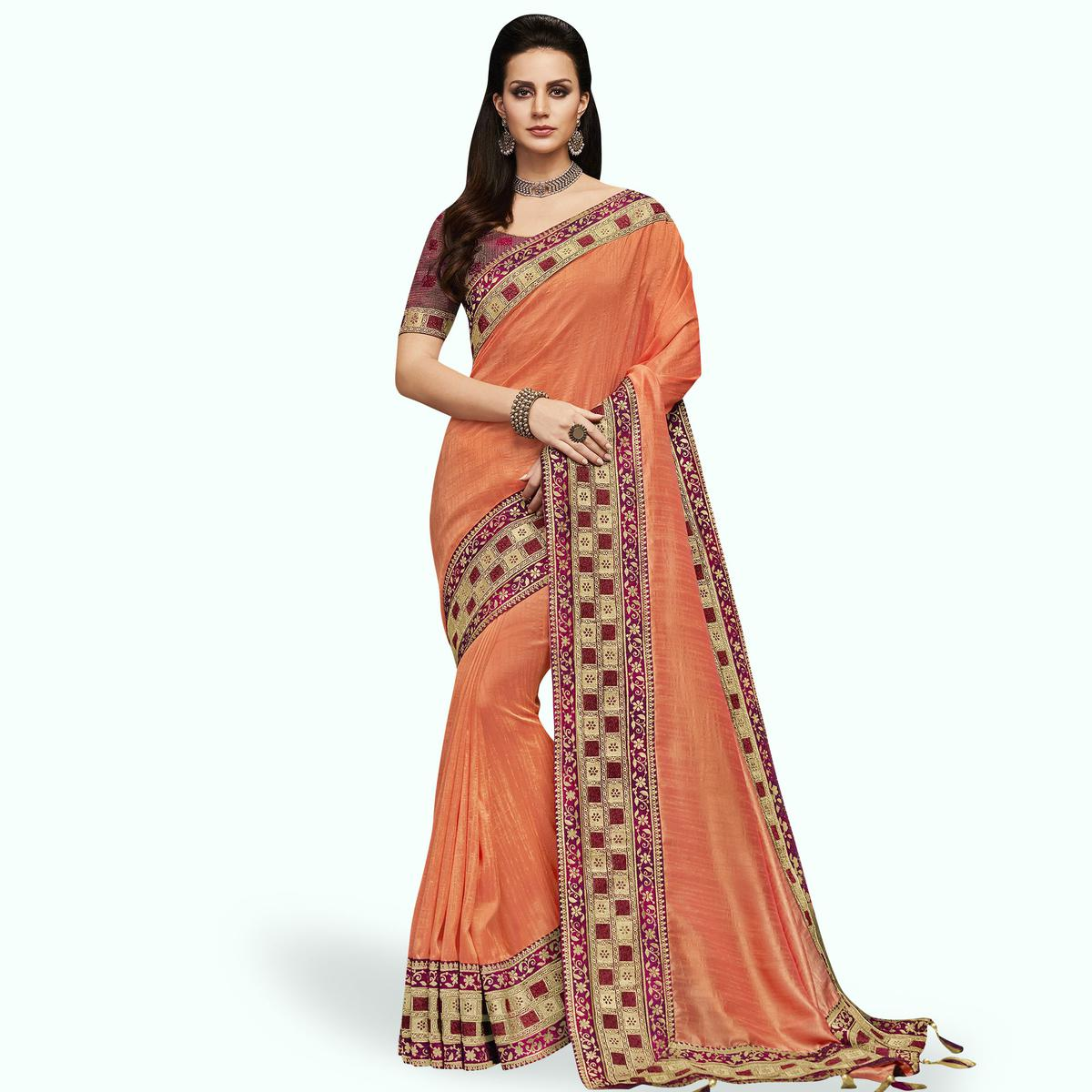 Engrossing Peach Colored Partywear Embroidered Satin Silk Saree