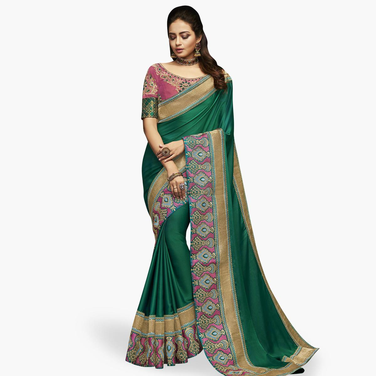 Innovative Green Colored Partywear Embroidered Satin Silk Saree