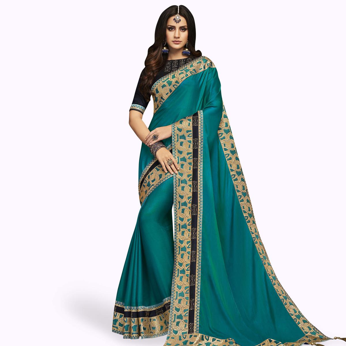 Gorgeous Blue Colored Partywear Embroidered Satin Silk Saree