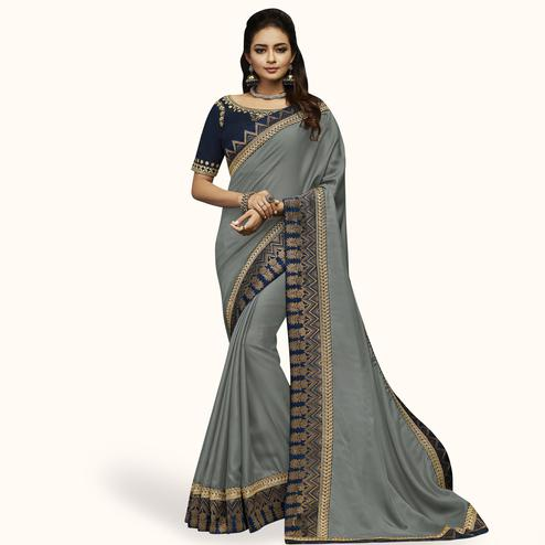 Imposing Gray Colored Partywear Embroidered Satin Silk Saree