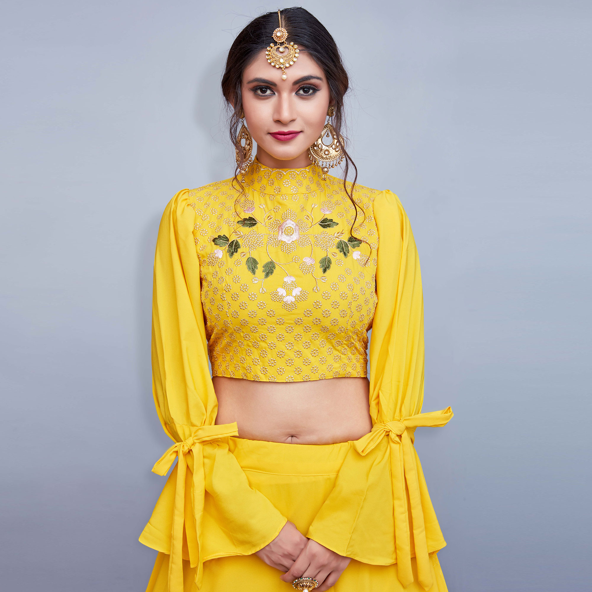 Yellow Colored Partywear Embroidered Crepe Lehenga Choli