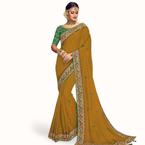 Ideal Mustard Yellow Colored Partywear Embroidered Chinon Silk Saree