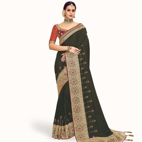 Imposing Dark Olive Green Colored Partywear Embroidered Chinon Silk Saree