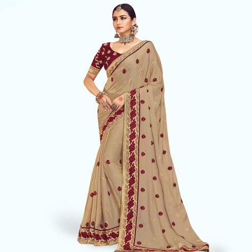 Lovely Beige Colored Partywear Embroidered Chinon Silk Saree