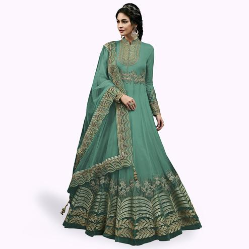 Fantastic Turquoise Green Colored Partywear Embroidered Abaya Style Netted Anarkali Suit