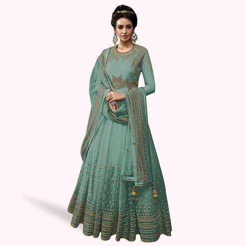 Energetic Sky Blue Colored Partywear Embroidered Abaya Style Netted Anarkali Suit
