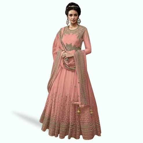 Glowing Pink Colored Partywear Embroidered Abaya Style Netted Anarkali Suit