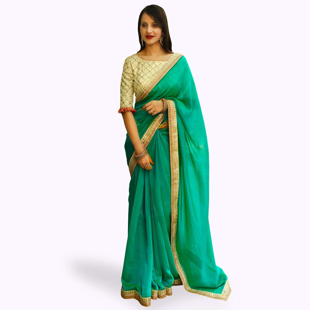 Magnetic Turquoise Green Colored Partywear Rangoli Silk Saree