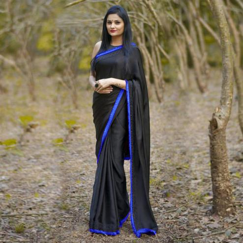Demanding Black-Blue Colored Partywear Georgette Saree