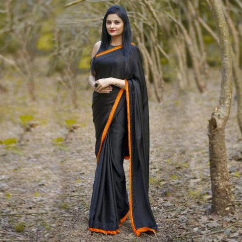 Fantastic Black-Orange Colored Partywear Georgette Saree