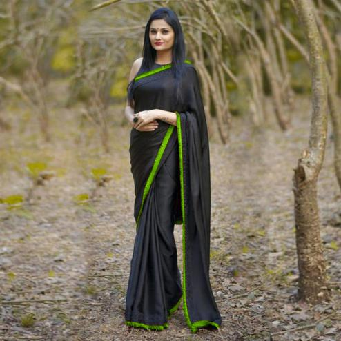 Classy Black-Green Colored Partywear Georgette Saree