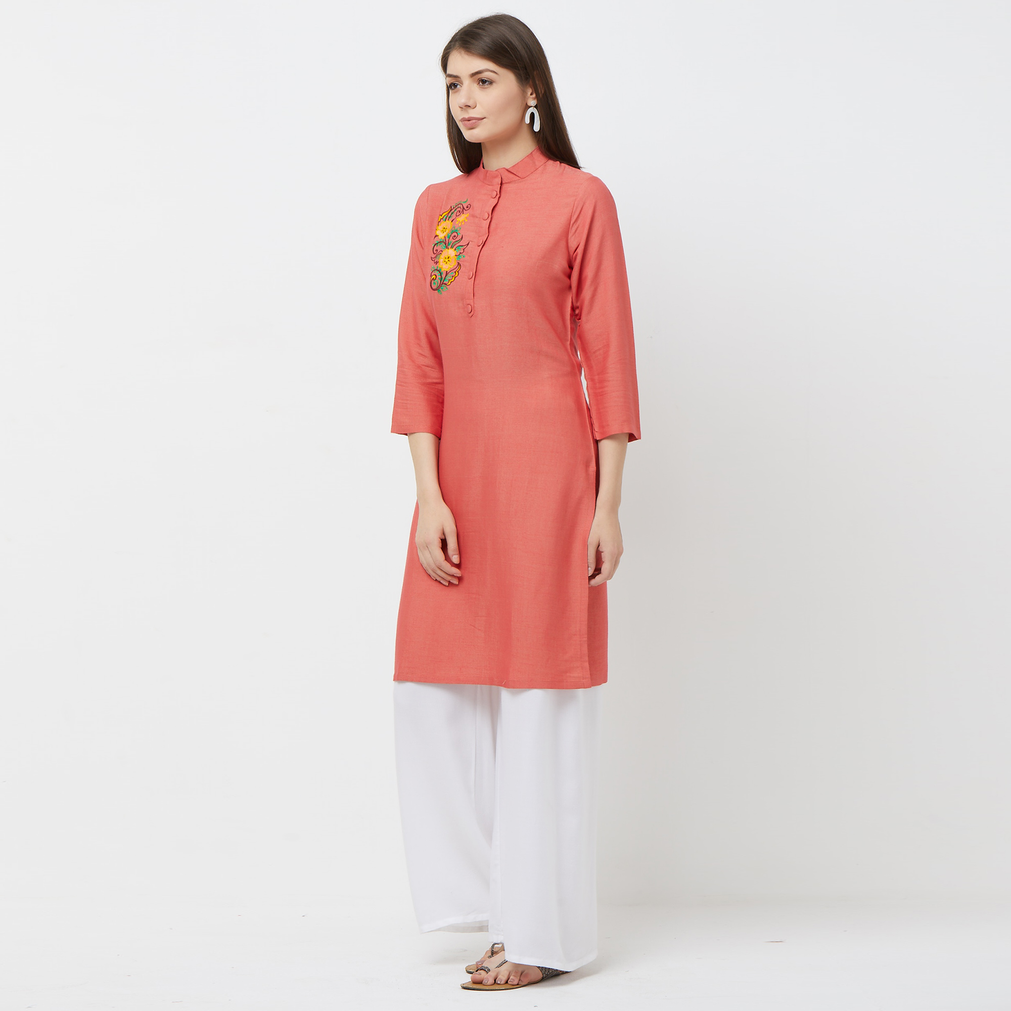 Adorning Peach Colored Casual Embroidered Cotton Kurti