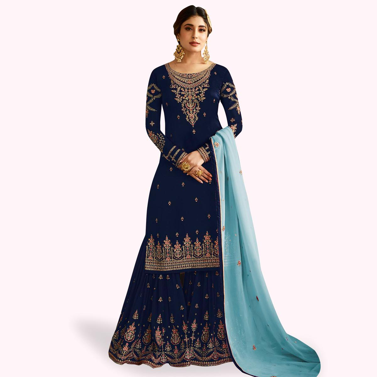 Capricious Navy Blue Colored Partywear Embroidered Faux Georgette Palazzo Suit