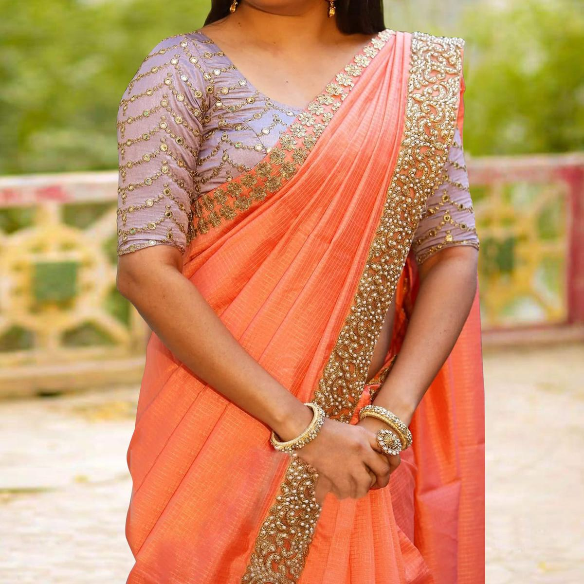 Amazing Orange Colored Partywear Embroidered Cotton Saree