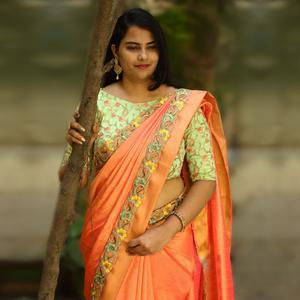 Gleaming Orange Colored Partywear Embroidered Silk Saree