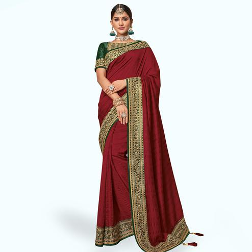 Gleaming Maroon Colored Partywear Embroidered Raw Silk Saree