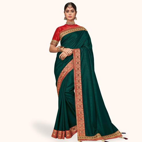 Unique Dark Green Colored Partywear Embroidered Raw Silk Saree