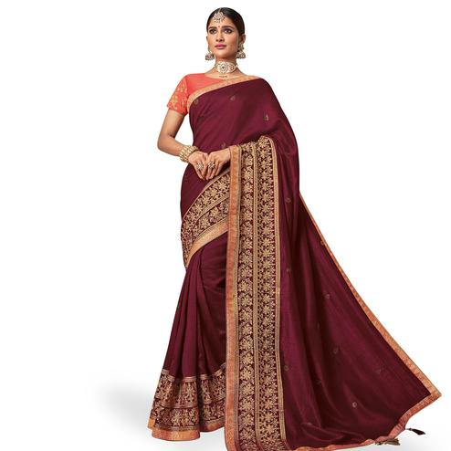 Refreshing Maroon Colored Partywear Embroidered Raw Silk Saree
