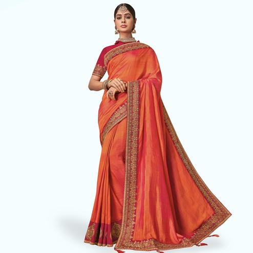 Flattering Orange Colored Partywear Embroidered Raw Silk Saree